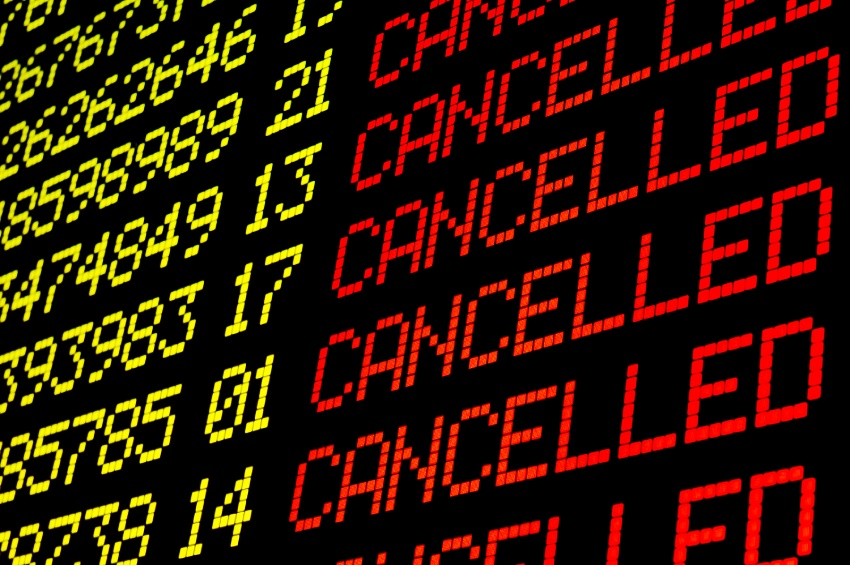 Flight cancellations on an information board