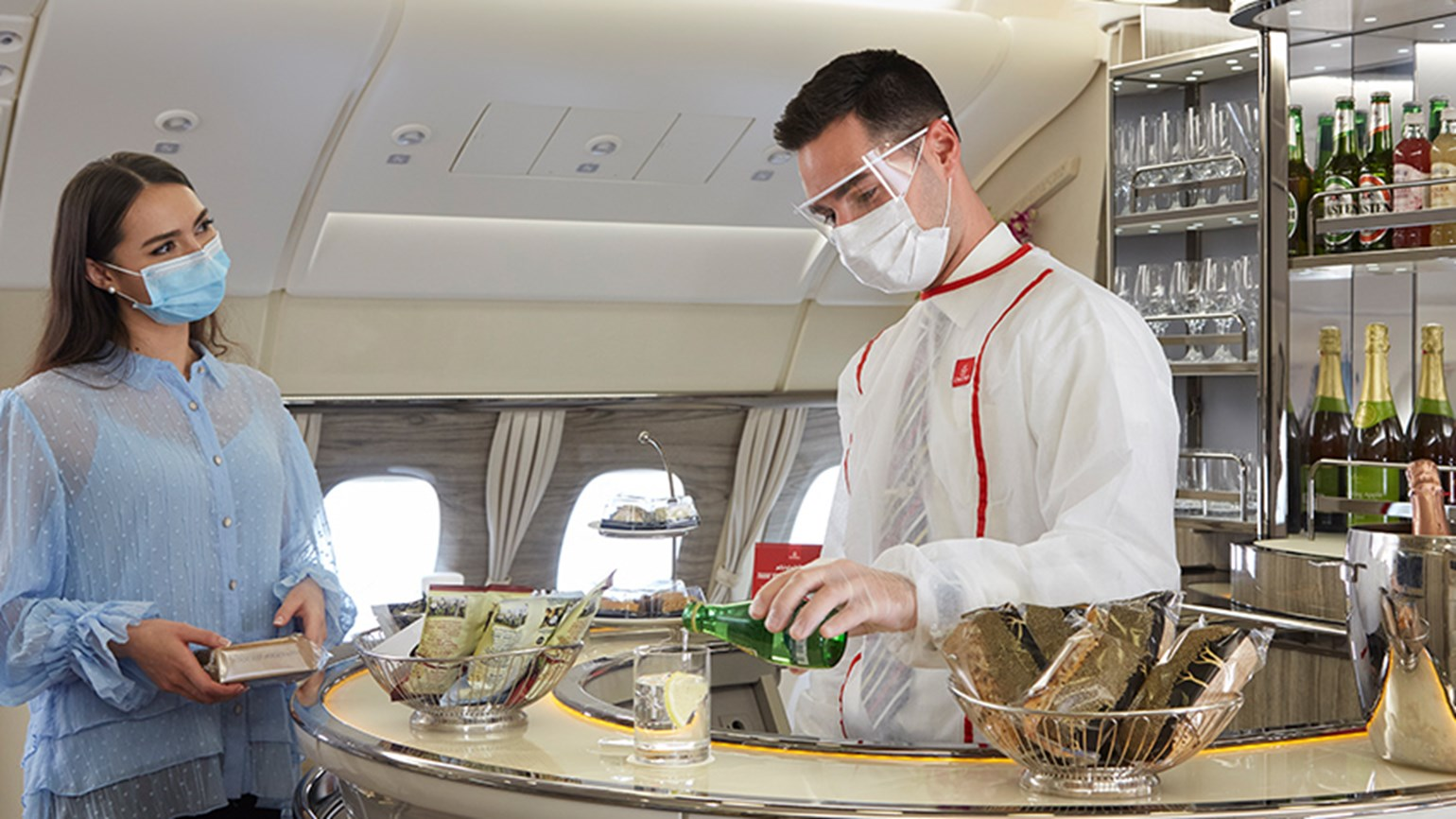 Emirates to cover passengers' Covid costs and restart onboard services